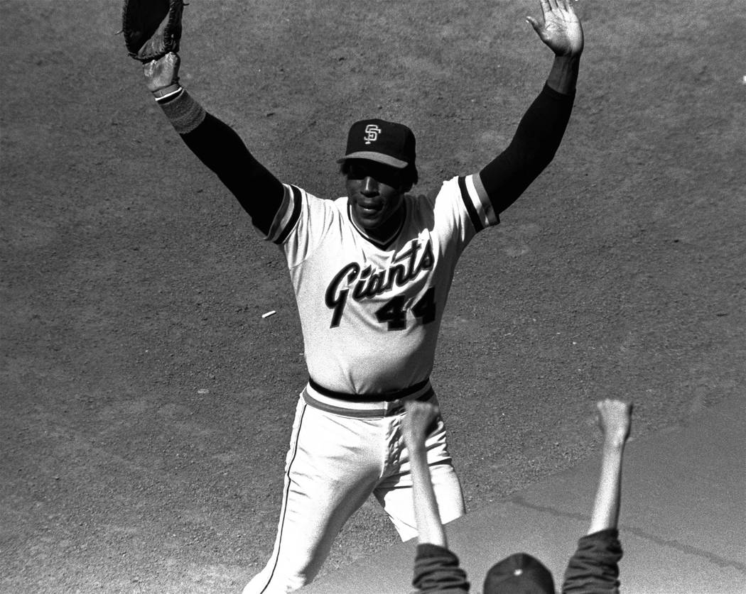 San Francisco Giants' Willie McCovey raises his hands in salute to the cheering crowd after he was replaced in the lineup in the team's baseball game with the Cincinnati Reds in San Francisco on J ...