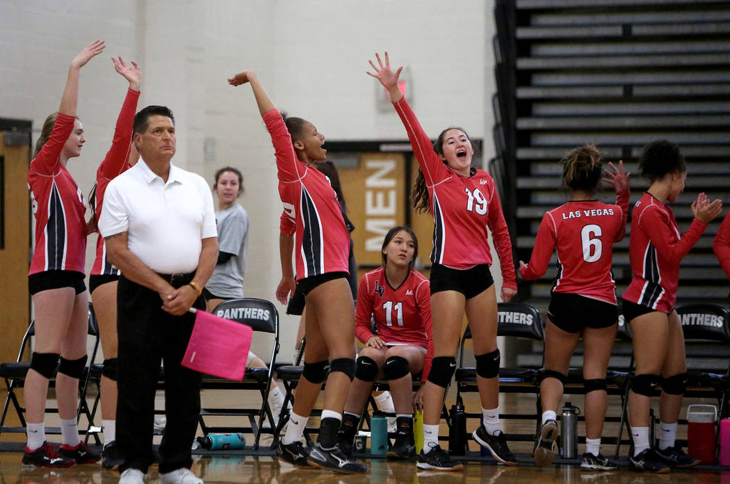 The Las Vegas High School Girls Varsity Volleyball team celebrates after winning a point against Cimarron Memorial High School at the Summerlin Center in Las Vegas, Wednesday, Oct. 31, 2018. Carol ...