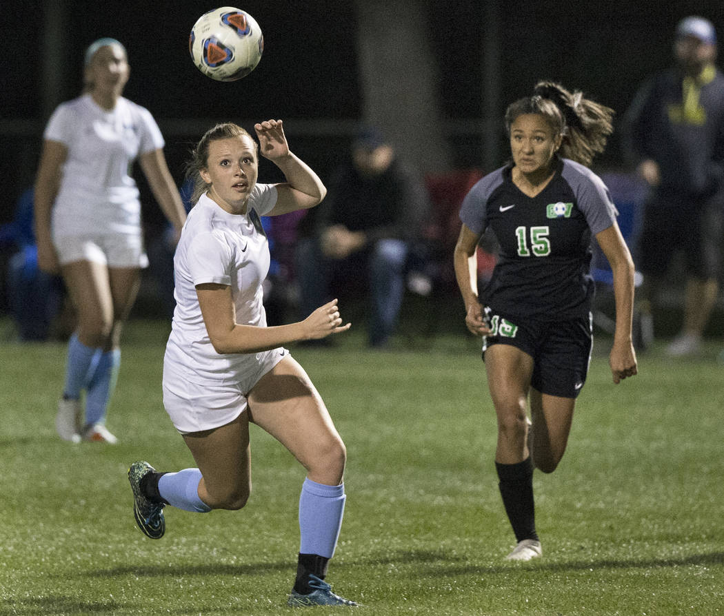 Foothill sophomore Aqui Williams (13) sprints for a loose ball with Green Valley junior forward Jazlyn Camacho (15) in the second half on Wednesday, October 31, 2018, at Bettye Wilson Park, in L ...