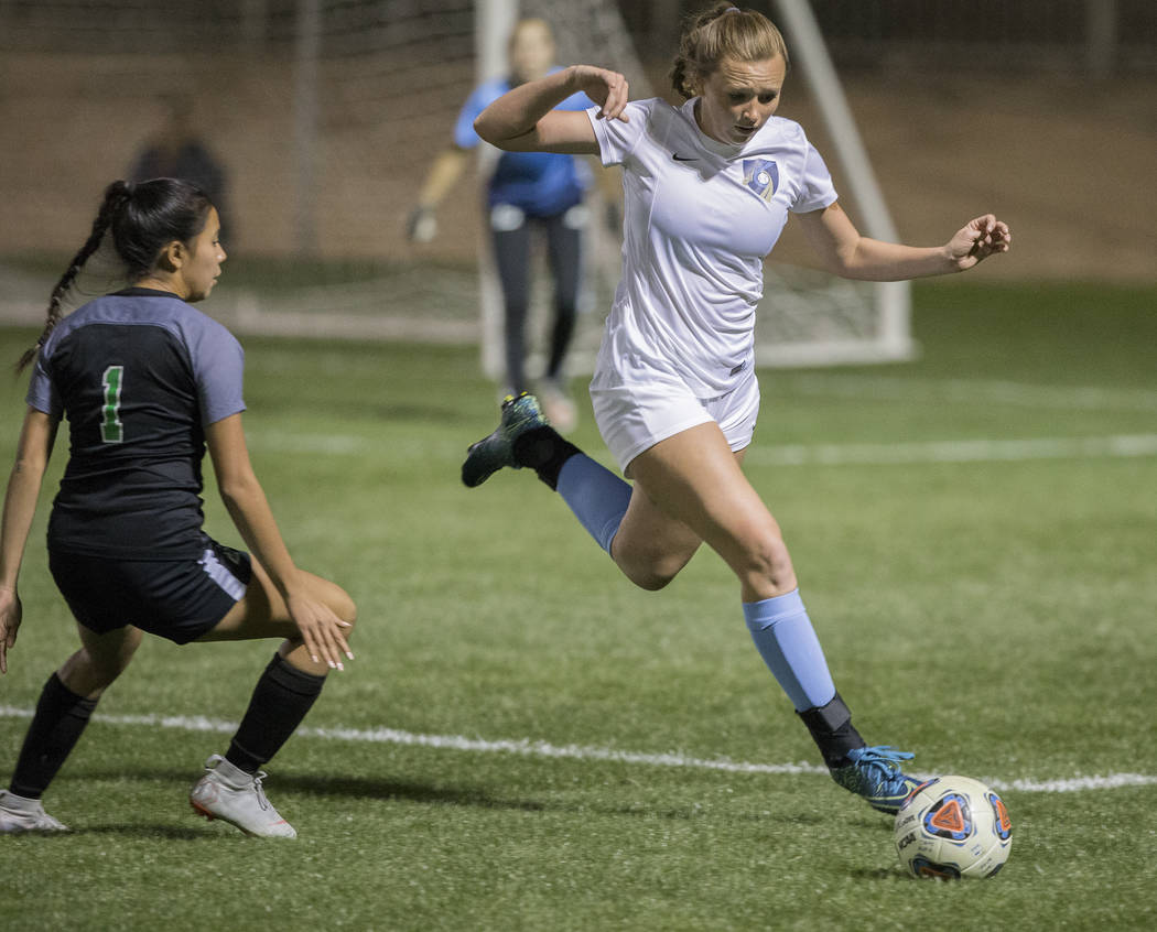 Foothill sophomore Aqui Williams (13) sprints for a loose ball with Green Valley junior defender Alyssa Marquez (1) in the second half on Wednesday, October 31, 2018, at Bettye Wilson Park, in Las ...