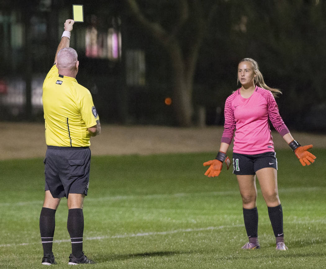 Green Valley junior goal keeper Nicolette De La Carrera (11) reacts after receiving a yellow card in the second half during the Gators game with Foothill High School on Wednesday, October 31, 2018 ...