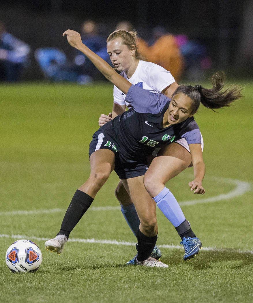 Green Valley junior forward Jazlyn Camacho (15) fights for a loose ball with Foothill sophomore Aqui Williams (13) in the second half on Wednesday, October 31, 2018, at Bettye Wilson Park, in Las ...