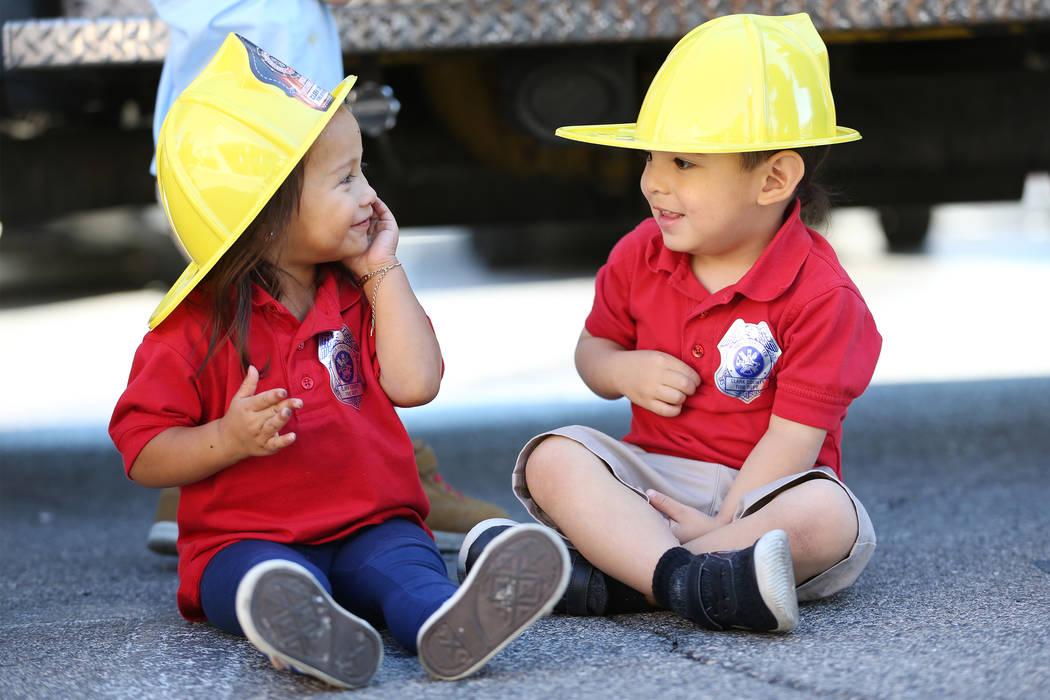 Aliyanna Lemos, 2, left, with Samuel De La Cruz, 2, during a fire awareness visit by Clark County Fire Department to Merryhill Preschool, 5055 S. Durango Dr., in Las Vegas, Wednesday, Oct. 24, 201 ...