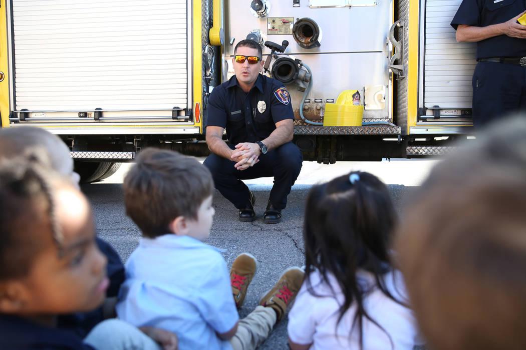 Clark County Fire Department Firefighter Adam Smith speaks to children during a fire awareness visit to Merryhill Preschool, 5055 S. Durango Dr., in Las Vegas, Wednesday, Oct. 24, 2018. Erik Verdu ...