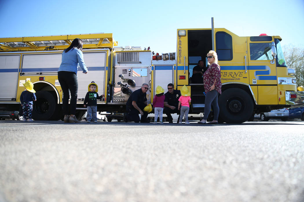 Children meet Clark County Fire Department firefighters during a fire awareness visit at Merryhill Preschool, 5055 S. Durango Dr., in Las Vegas, Wednesday, Oct. 24, 2018. Erik Verduzco Las Vegas R ...