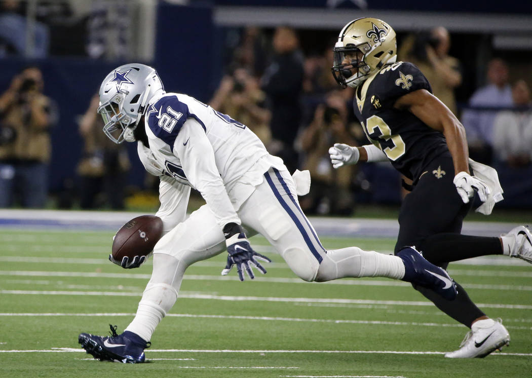 Dallas Cowboys running back Ezekiel Elliott (21) runs past New Orleans Saints free safety Marcus Williams (43) during the second half of an NFL football game, in Arlington, Texas, Thursday, Nov. 2 ...