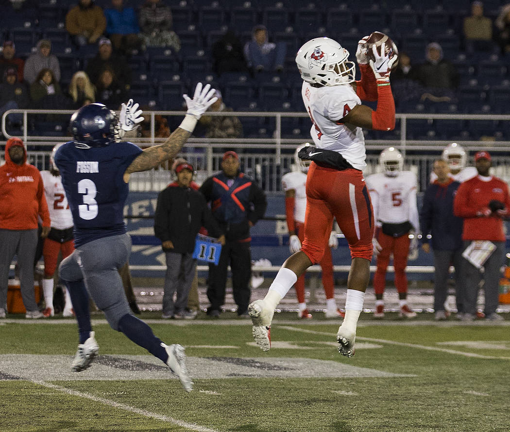 Fresno State defensive back Mike Bell (4) jumps in front of Nevada's wide receiver Kaleb Fossum (3) and makes an interception in the first half of an NCAA college football game in Reno, Nev., Satu ...