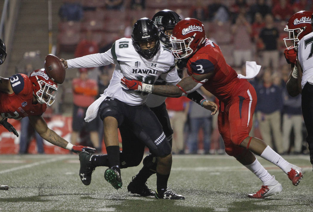 Hawaii quarterback Jeremy Moussa is sacked by Fresno State defensive end Mykal Walker during the second half of an NCAA college football game in Fresno, Calif., Saturday, Oct. 27, 2018. Fresno Sta ...