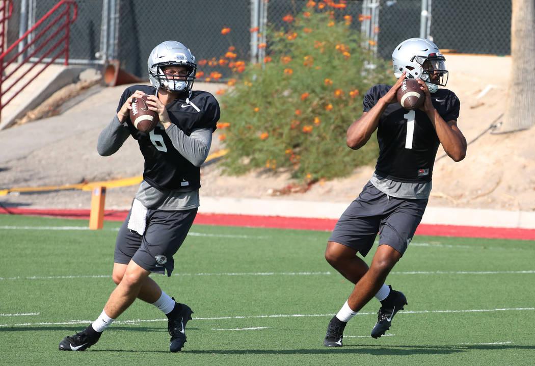 UNLV backup quarterback Max Gilliam, left, and quarterback Armani Rogers (1) prepare to throw the ball during team practice on Thursday, Aug. 9, 2018, in Las Vegas. Bizuayehu Tesfaye/Las Vegas Rev ...