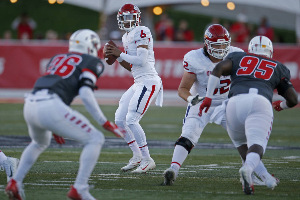 Fresno State quarterback Marcus McMaryion (6) searches for a receiver during the first half of an NCAA college football game against New Mexico in Albuquerque, N.M., Saturday, Oct. 20, 2018. (AP P ...