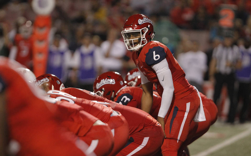 Fresno State quarterback Marcus McMaryion leads the team against Wyoming during the second half of an NCAA college football game in Fresno, Calif., Saturday, Oct. 13, 2018. (AP Photo/Gary Kazanjian)
