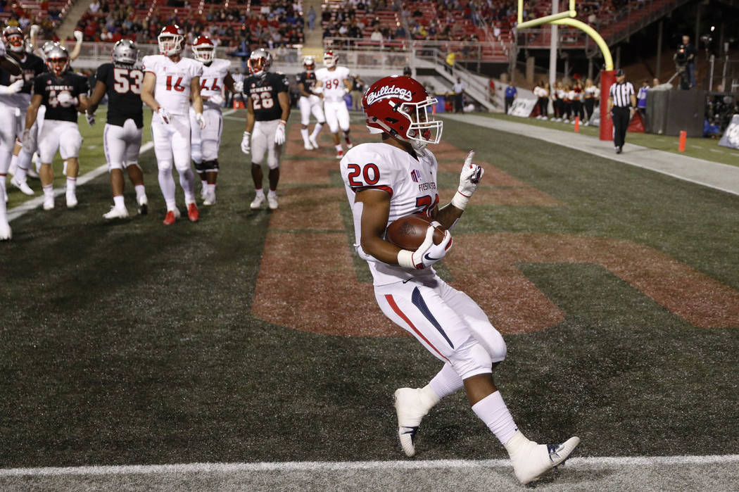 Fresno State Bulldogs running back Ronnie Rivers celebrates scoring a touchdown against the UNLV Rebels during the first half of an NCAA college football game Saturday, Nov. 3, 2018, in Las Vegas. ...