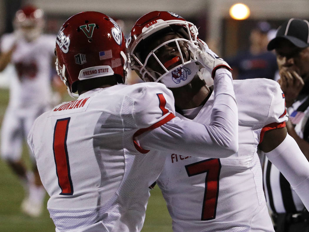 Fresno State Bulldogs wide receiver Jamire Jordan (1) celebrates after wide receiver Derrion Grim (7) scored against the UNLV Rebels during the second half of an NCAA college football game Saturda ...