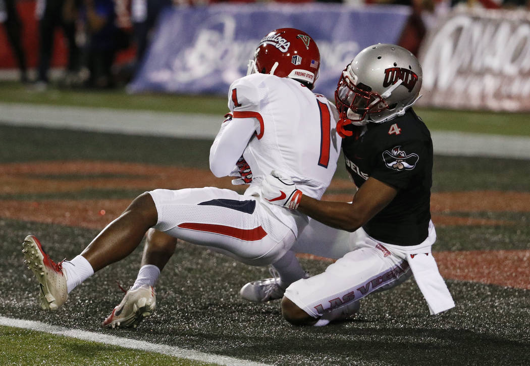 Fresno State Bulldogs wide receiver Jamire Jordan (1) scores a touchdown against UNLV Rebels defensive back Alex Perry during the first half of an NCAA college football game Saturday, Nov. 3, 2018 ...