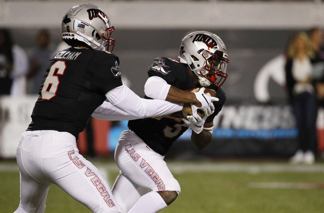 UNLV Rebels quarterback Max Gilliam (6) hands the balls off to UNLV Rebels running back Lexington Thomas during the first half of an NCAA college football game Saturday, Nov. 3, 2018, in Las Vegas ...