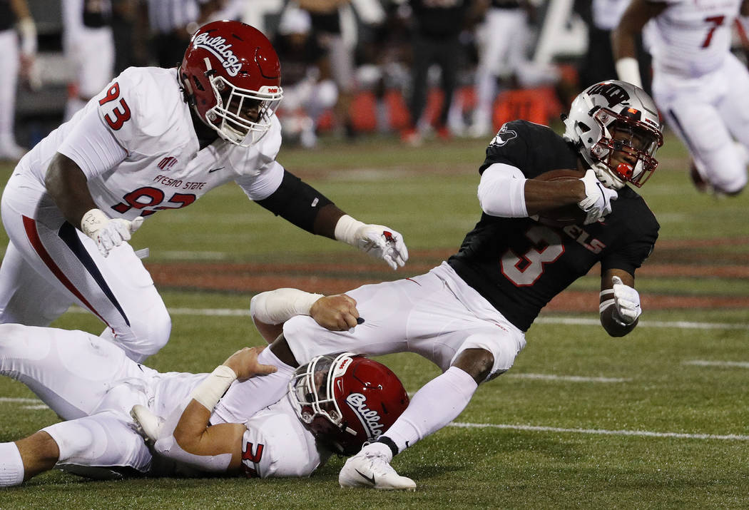 Fresno State Bulldogs linebacker George Helmuth (34) tackles UNLV Rebels running back Lexington Thomas (3) during the first half of an NCAA college football game Saturday, Nov. 3, 2018, in Las Veg ...