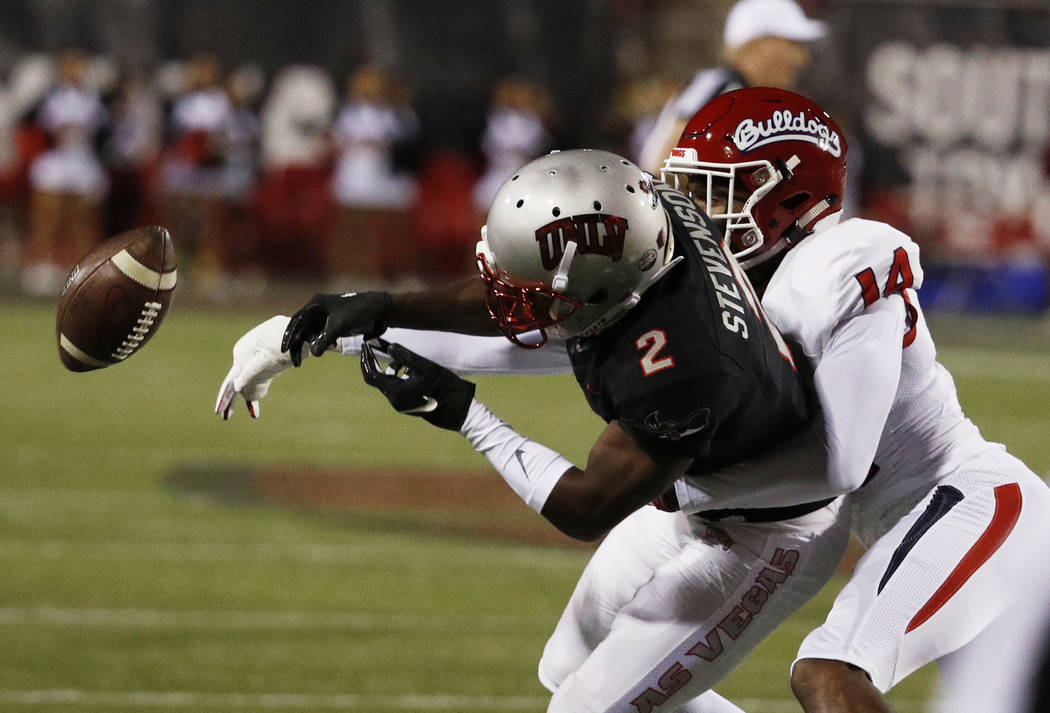 UNLV Rebels wide receiver Mekhi Stevenson (2) misses a catch while covered by Fresno State Bulldogs defensive back Jaron Bryant during the first half of an NCAA college football game Saturday, Nov ...