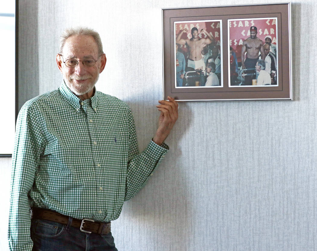 Marc Ratner, former executive director of the Nevada Athletic Commission, shows a weigh-in photo that hangs in his office at the UFC headquarters from the Riddick Bowe-Evander Holyfield rematch on ...
