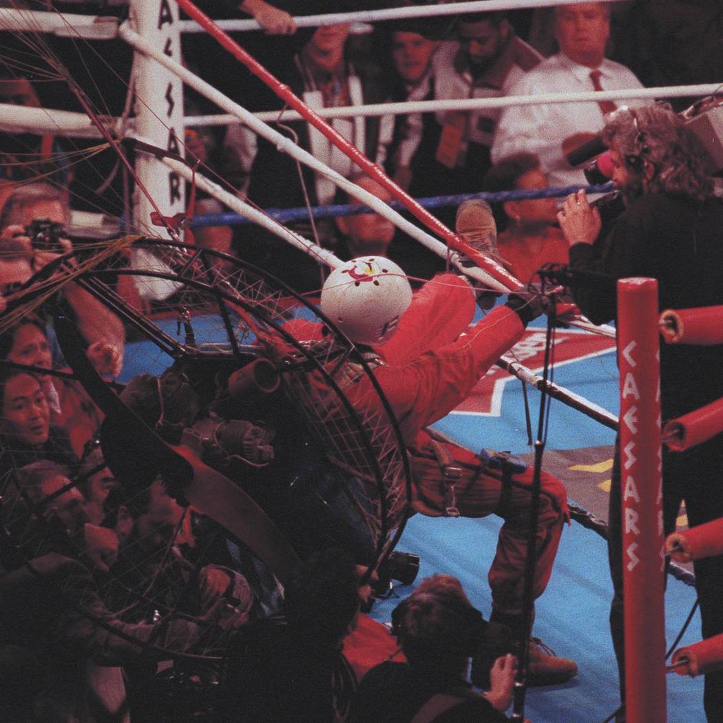 """James """"Fan Man"""" Miller crashes near the ring in his motorized paraglider during the seventh round of the Riddick Bowe-Evander Holyfield heavyweight championship fight on Nov. 6, 1993, at the C ..."""