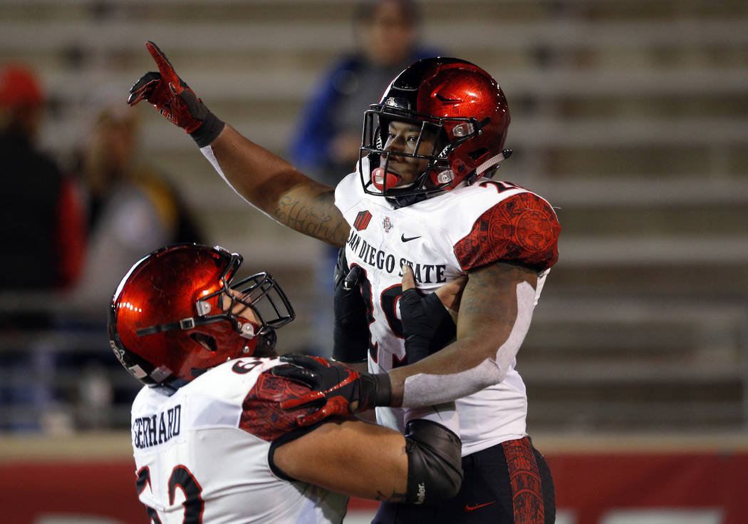 San Diego State running back Juwan Washington, right, celebrates with teammate Nick Gerhard after scoring a touchdown during the second half of an NCAA college football game in Albuquerque, N.M., ...