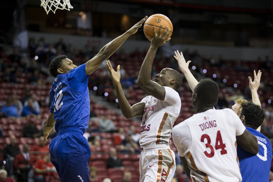 UNLV Rebels guard Kris Clyburn (1) shoots for a score against pressure from Air Force Falcons forward Lavelle Scottie (12) in the first half of the Mountain West Conference men's basketballtourn ...