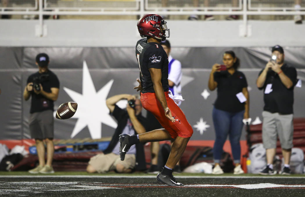 UNLV Rebels quarterback Armani Rogers (1) scores a touchdown against the Prairie View A&M Panthers during the first half of a football game at Sam Boyd Stadium in Las Vegas on Saturday, Sept. ...