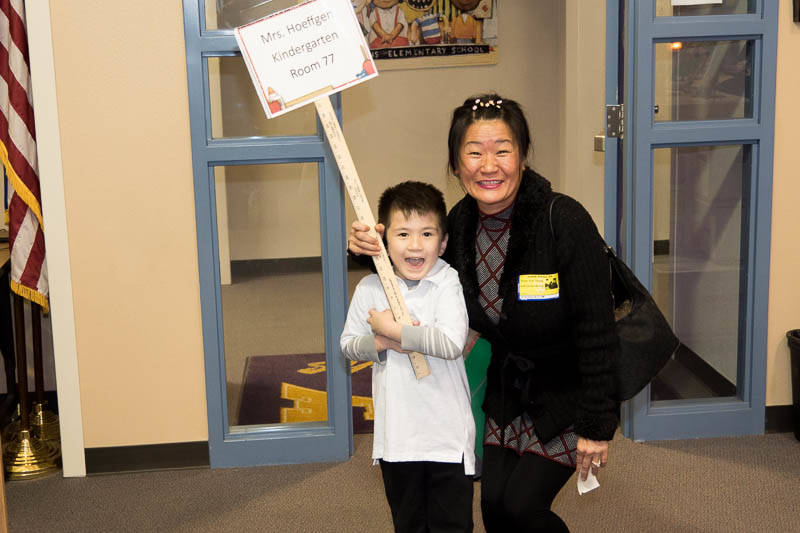 GLVAR member Eun Yoon and her son were among the volunteers participating in the Realtors in the Classroom event Oct. 19 at two local schools. (GLVAR)