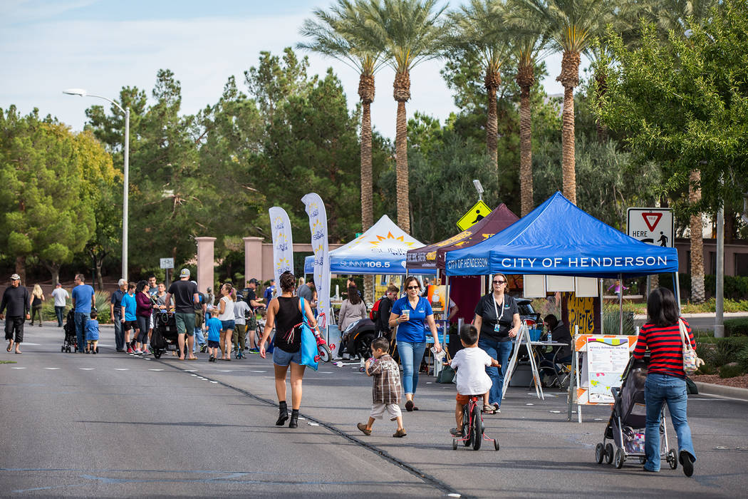 Hendeson Stroll 'n Roll participants check out a few of the informational tents stationed along the route. Courtesy City of Henderson