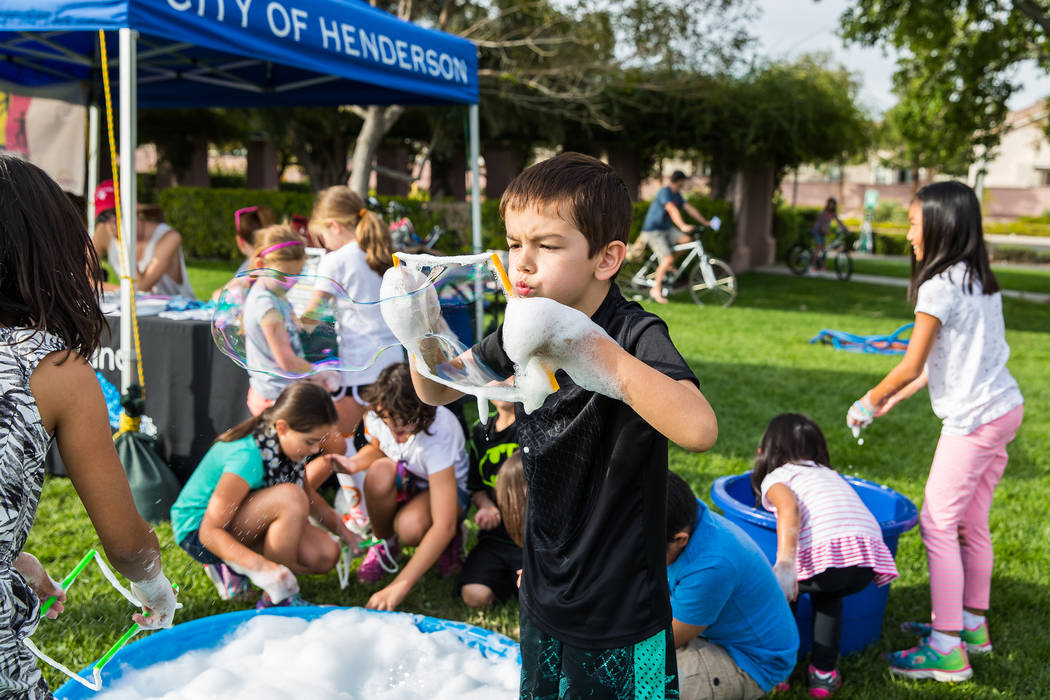 A Henderson Stroll 'n Roll participant takes a break to create a giant bubble. Courtesy City of Henderson