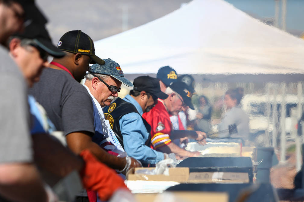 Veteran volunteers grill hamburgers and hot dogs at the 4th Annual Veterans Day Car Show and BBQ in celebration of Veterans Day at the VA Southern Nevada Healthcare System Medical Center in North ...