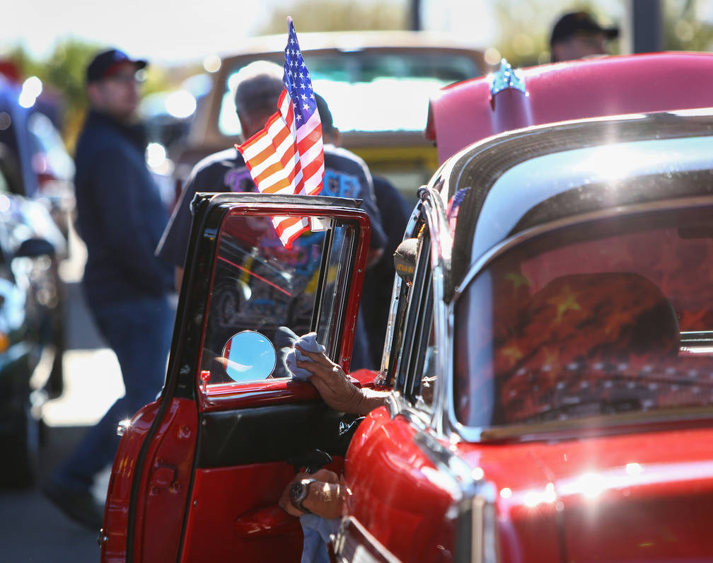 Egon Admann wipes the window of his 1957 Chevrolet Bel Air at the 4th Annual Veterans Day Car Show and BBQ in celebration of Veterans Day at the VA Southern Nevada Healthcare System Medical Center ...