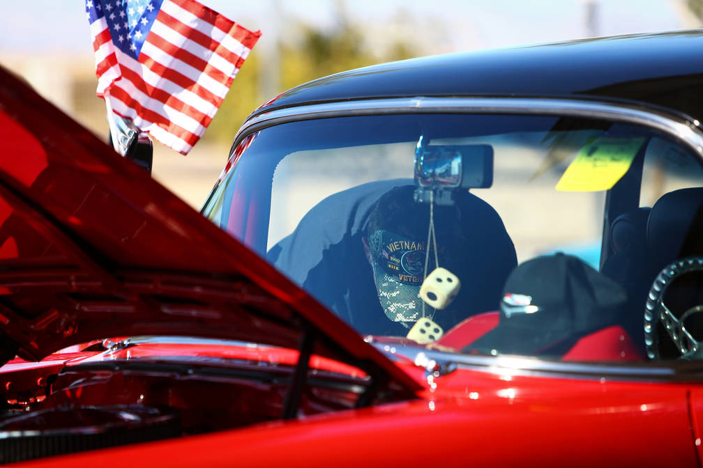 Egon Admann wipes down his 1957 Chevrolet Bel Air at the 4th Annual Veterans Day Car Show and BBQ in celebration of Veterans Day at the VA Southern Nevada Healthcare System Medical Center in North ...