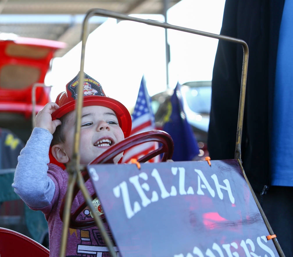 Lennon Shay, 2, from Las Vegas sits in one of the Shrine Flivvers' miniature cars at the 4th Annual Veterans Day Car Show and BBQ in celebration of Veterans Day at the VA Southern Nevada Healthcar ...
