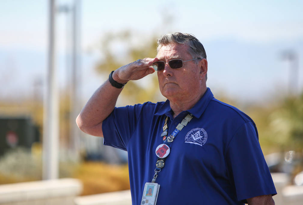 Air Force Veteran John A Istle salutes as the National Anthem is sung at the 4th Annual Veterans Day Car Show and BBQ in celebration of Veterans Day at the VA Southern Nevada Healthcare System Med ...