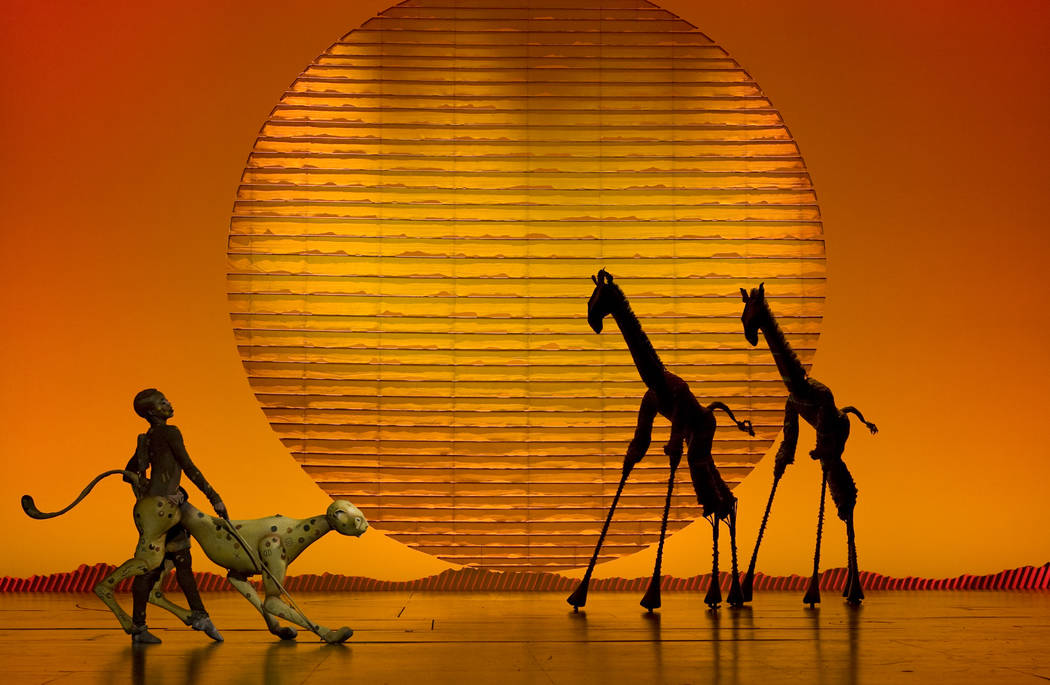 """The cheetah and giraffes in the opening number, """"The Circle of Life,"""" from """"The Lion King."""" (Joan Marcus/The Smith Center)"""