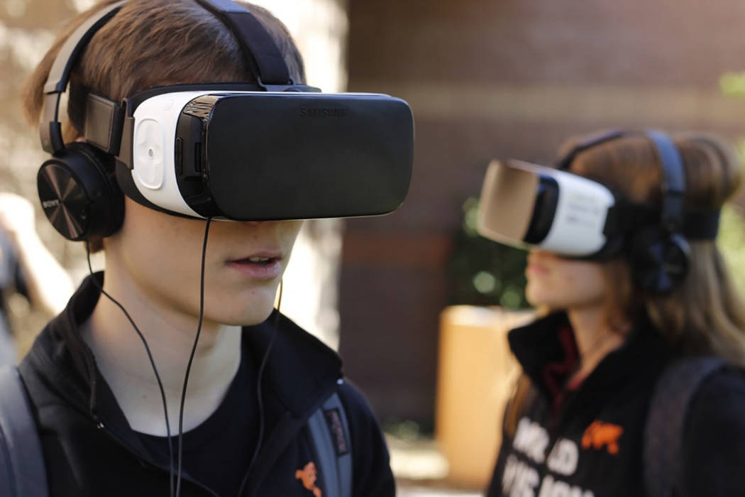 Tom Riggleman and Haley Lilla, seniors at Faith Lutheran High School use virtual reality headsets to step back in time and visit Kenya again. They were two of eight students who traveled to the v ...