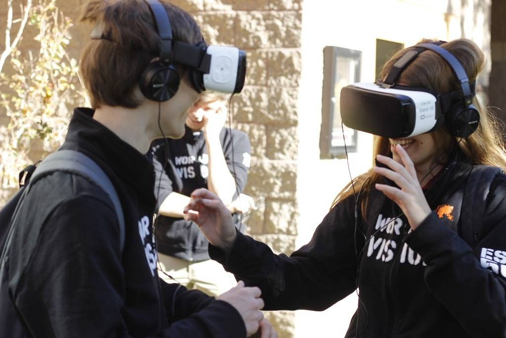 Tom Riggleman,17, and Haley Lilla, 17, seniors at Faith Lutheran High School use virtual reality headsets to step back in time and visit Kenya again. They were two of eight students who traveled ...