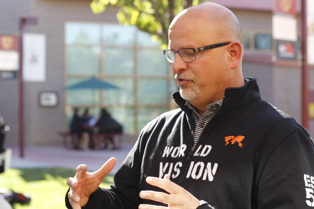 Principal Scott Fogo explains the Kenya Project to a student on Wednesday, Oct. 24. Faith Lutheran took a handful of students to Kenya through a partnership with World Vision, a Christian non-pro ...