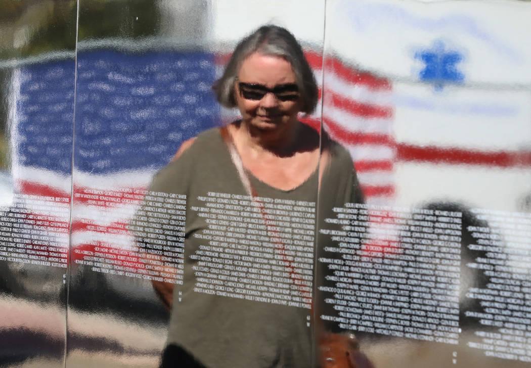 Rusty Lofink is reflected in a half-size replica of the Vietnam Veterans Memorial wall on Friday, Nov. 2, 2018, in Las Vegas. (Bizuayehu Tesfaye/Las Vegas Review-Journal) @bizutesfaye