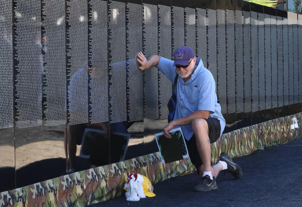 Carl Adelhock takes a moment as he visits a half-size replica of the Vietnam Veterans Memorial wall on Friday, Nov. 2, 2018, in Las Vegas. (Bizuayehu Tesfaye/Las Vegas Review-Journal) @bizutesfaye