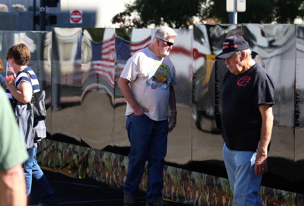 Vietnam Marine Corps Veteran James Lawrence, center, visits a half-size replica of the Vietnam Veterans Memorial wall on Friday, Nov. 2, 2018, in Las Vegas. (Bizuayehu Tesfaye/Las Vegas Review-Jou ...