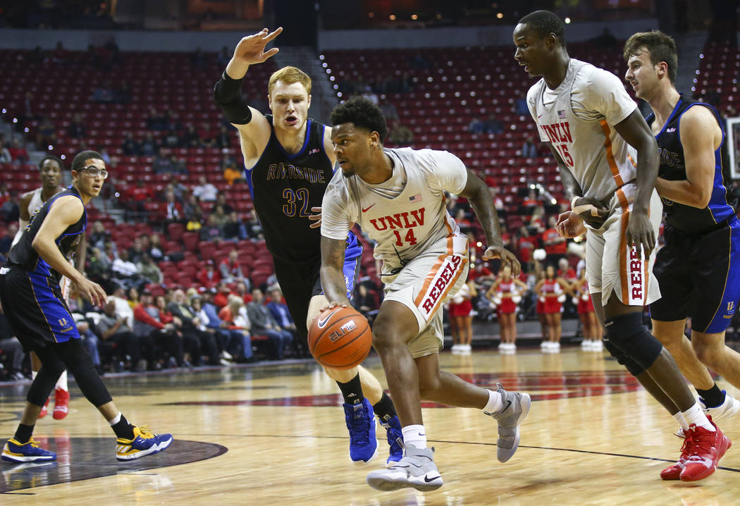 UNLV Rebels forward Tervell Beck (14) drives to the basket against UC Riverside Highlanders center Menno Dijkstra (32) during the first half of a basketball game at the Thomas & Mack Center in ...