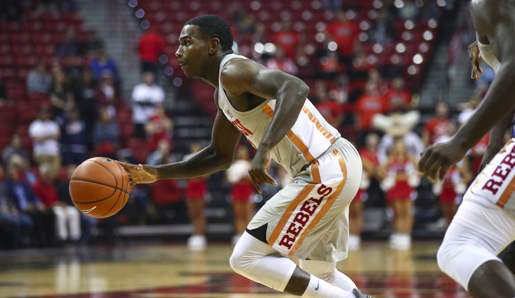 UNLV Rebels guard Amauri Hardy (3) drives the ball against the UC Riverside Highlanders during the first half of a basketball game at the Thomas & Mack Center in Las Vegas on Tuesday, Nov. 13, ...