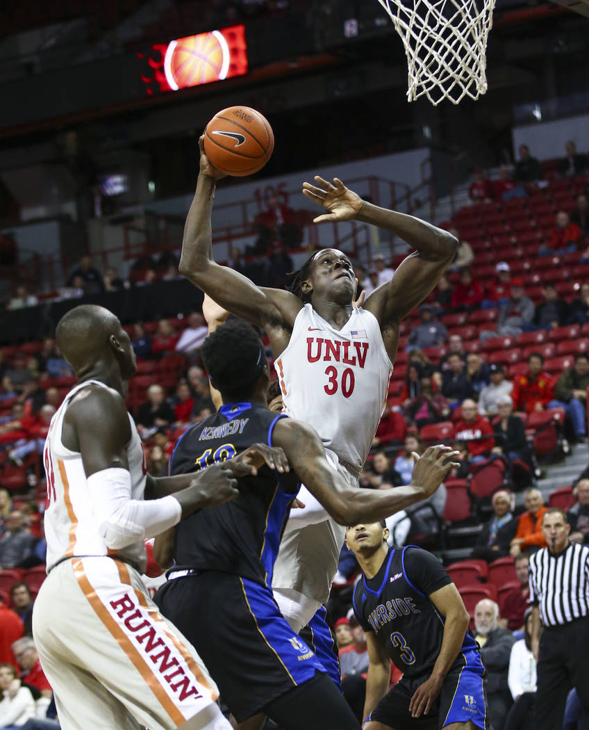 UNLV Rebels forward Jonathan Tchamwa Tchatchoua (30) goes to the basket to dunk against the UC Riverside Highlanders during the second half of a basketball game at the Thomas & Mack Center in ...
