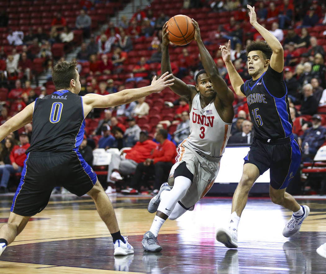 UNLV Rebels guard Amauri Hardy (3) =tb= between UC Riverside Highlanders guards Dragan Elkaz (0) and Dikymbe Martin (15) during the second half of a basketball game at the Thomas & Mack Center ...