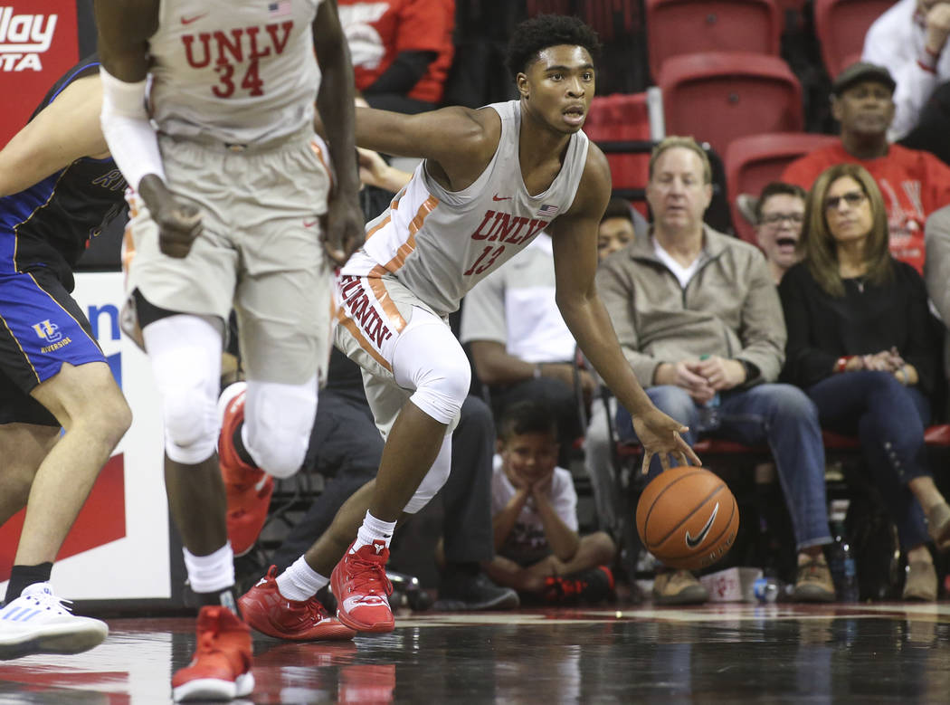 UNLV Rebels guard Bryce Hamilton (13) brings the ball up court against the UC Riverside Highlanders during the second half of a basketball game at the Thomas & Mack Center in Las Vegas on Tues ...