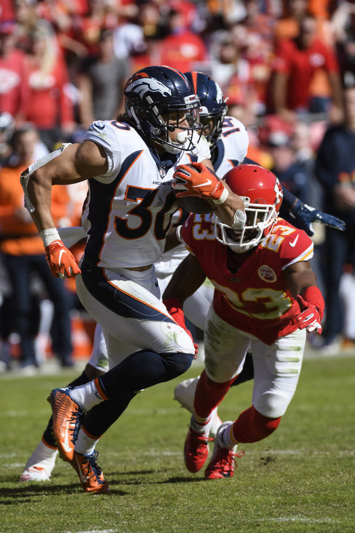 Denver Broncos running back Phillip Lindsay (30) in action against the Kansas City Chiefs during an NFL game on Sunday Oct. 28, 2018 in Kansas City, Mo. (AP Photo/Reed Hoffmann)