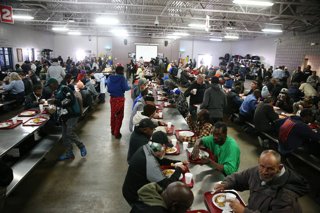 People eat lunch in the dining room at the Catholic Charities of Southern Nevada in Las Vegas, Wednesday, Nov. 14, 2018. Erik Verduzco Las Vegas Review-Journal @Erik_Verduzco