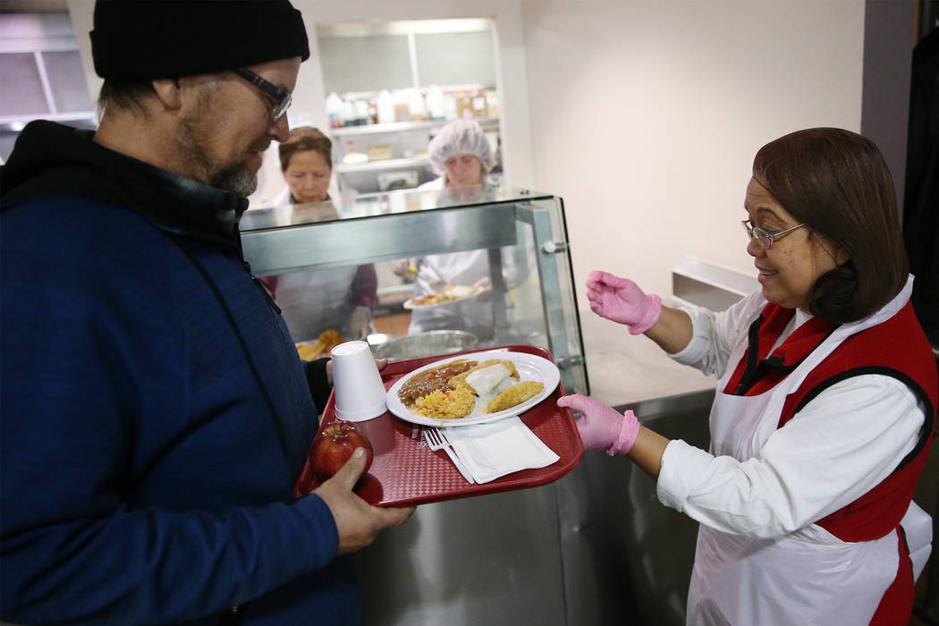 Volunteer Mary Lou Castaneda, right, serves a lunch meal for Dan Page in the dining room of the Catholic Charities of Southern Nevada in Las Vegas, Wednesday, Nov. 14, 2018. Erik Verduzco Las Vega ...