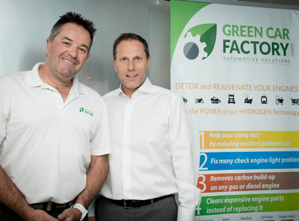 Jean-Luc Montagnier and Stephane Di Pascuale, owners of the Green Car Factory, are exhibiting their technology this week at SEMA, currently being held at the Las Vegas Convention Center. (Tonya Ha ...
